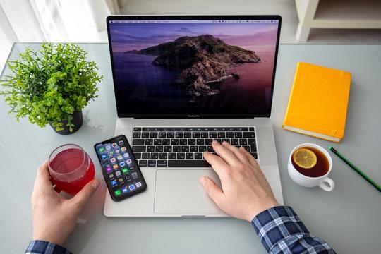 Backgrounds MacOS Catalina on screen MacBook Pro 16 iPhone 11
