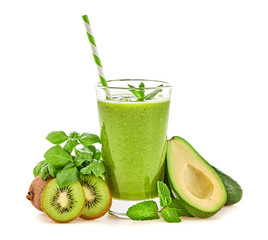 Avocado, basil, kiwi, fruit green smoothie in glass. Detox fresh healthy diet concept. Basil, avocado, fruit vegan smoothie isolated on white. Greens homemade vegetarian smoothie cocktail