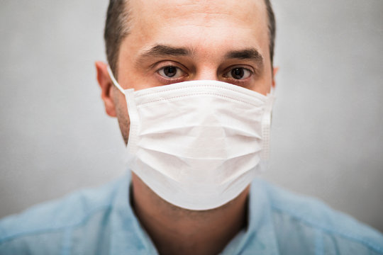 Man wearing protection face mask against coronavirus