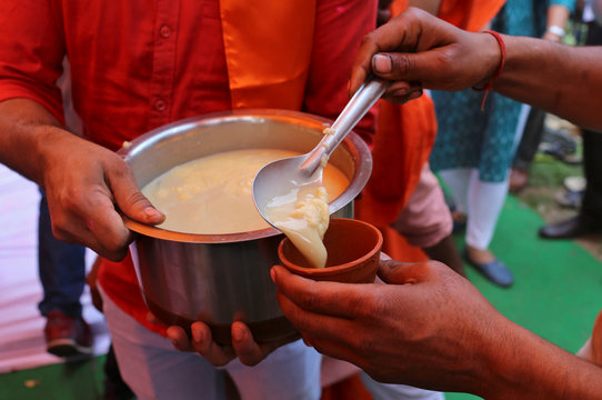 Members of All India Hindu Mahasabha serve a traditional drink with cow urine as an ingredient during a gaumutra (cow urine) party, which according to them helps in warding off coronavirus disease (COVID-19), in New Delhi
