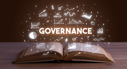 GOVERNANCE inscription coming out from an open book, business concept