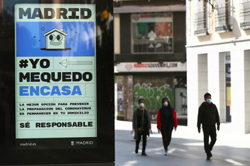 Ad advising people to be responsible and stay home is displayed in central Madrid