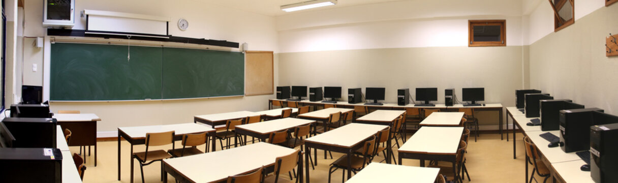 interior of a classroom with row of computers