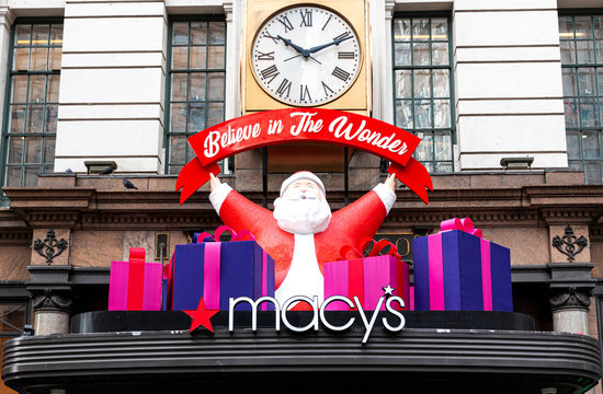 Santa claus decoration over the entrance of Macy's in New York City