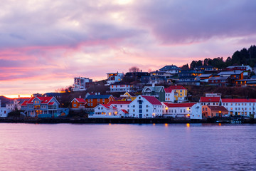 Wall Mural - View of city center of Kristiansund, Norway during the cloudy morning at sunrise with colorful sky
