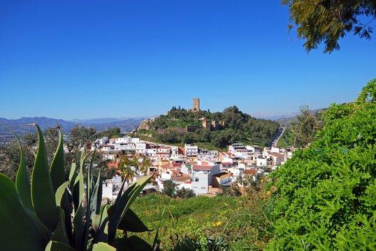 View over the town rooftops towards the Moorish castle, Velez Malaga, Spain.