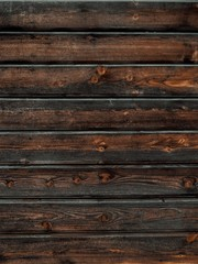Foto op Aluminium Chinese Muur Vertical closeup of a wooden plank wall - great for backgrounds and wallpapers