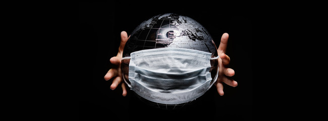 Kid holding globe map sphere isolated on black horizontal background. Ecological problems disasters. COVID-19 pandemic infection disease concept image, copy space for text