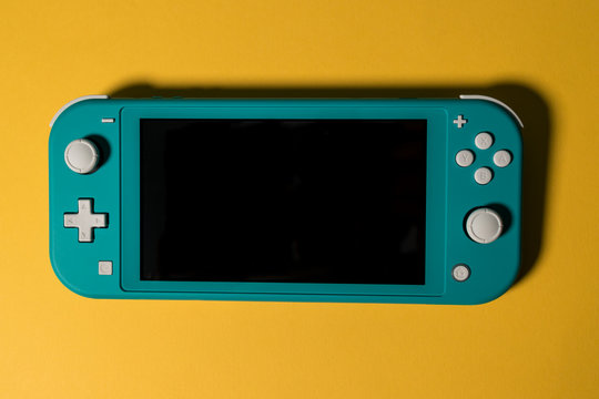 LONDON - MARCH 12, 2020: Nintendo Switch Lite handheld video game console