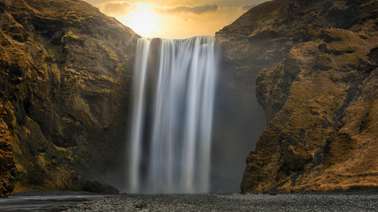 skogafoss waterfall in iceland at sunset