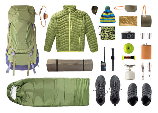 Flat lay of camping equipment and trekking clothes isolated on white background. Top view of shoes and accessories for travel