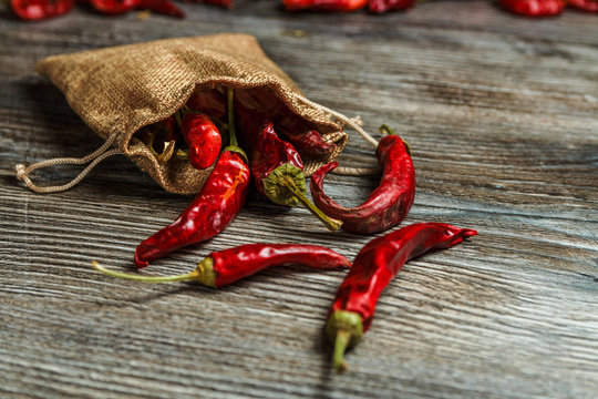 mexican food. dried red hot chilli pepper on wooden background. spicy taste