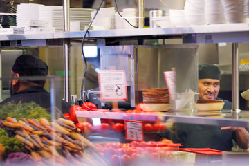 A chef works in the kitchen at the Athenian Seafood Restaurant in the Public Market in Seattle