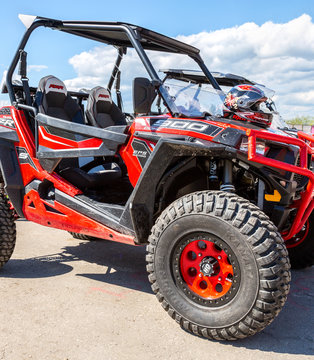 Red atv quad bikes Polaris parked at the city street
