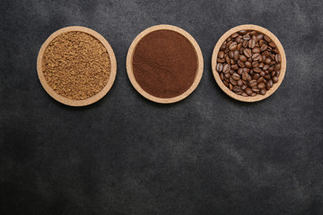 Coffee various - roasted beans or grain and ground and instant coffee on black fabric background. The sequence of preparation of the drink. Coffee concept. Flat lay. Top view. Copy space for text.