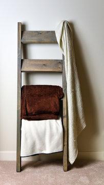 Trendy vertical rustic blanket ladder with blankets hanging