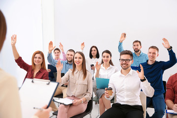 Foto op Aluminium Dance School People raising hands to ask questions at business training indoors