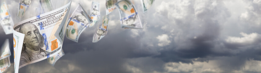 Several 100 Dollar Bills Falling From Stormy Cloudy Sky Banner