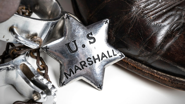 Western themed United States Marshall badge with cowboy boots and spurs