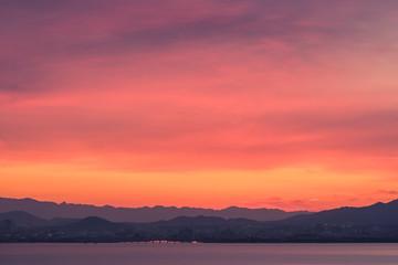 Foto op Aluminium Koraal A beautiful sunrise over Lake Biwa in Shiga Prefecture, Japan.