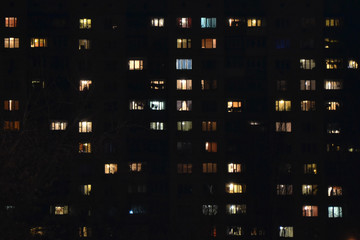 Apartment building at night. People staying at home Wall mural