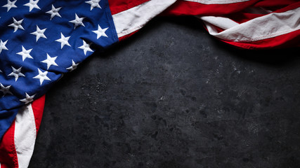 US American flag on worn black background. For USA Memorial day, Veteran's day, Labor day, or 4th of July celebration. With blank space for text. Fotoväggar