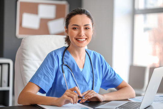 Young female doctor working in clinic