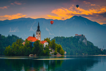 Wall Mural - Hot air balloons over the lake Bled at sunrise, Slovenia