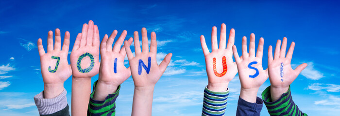 Children Hands Building Colorful English Word Join Us. Blue Sky As Background