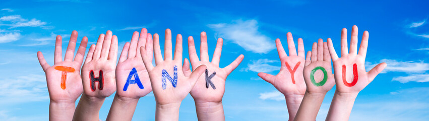 Many Children Hands Building Colorful Word Thank You. Blue Sky As Background