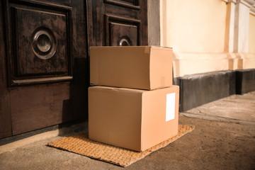 Delivered parcels on door mat near entrance
