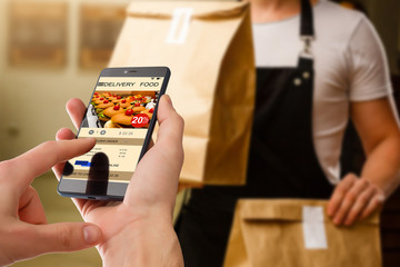 man holding touch phone with app delivery food screen