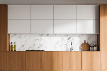White marble kitchen with wooden countertops