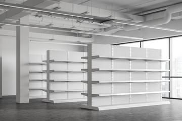 Fototapeta Empty shelves in white supermarket corner obraz