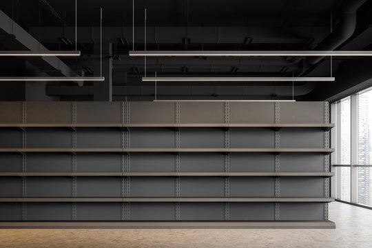 Empty shelves in gray supermarket