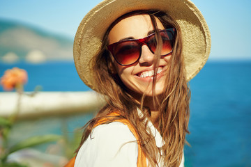 Closeup bright portrait joyful woman tourist in straw hat and sunglasses looking to camera wiht smile. Fotomurales