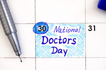 Reminder National Doctors Day in calendar with blue pen.
