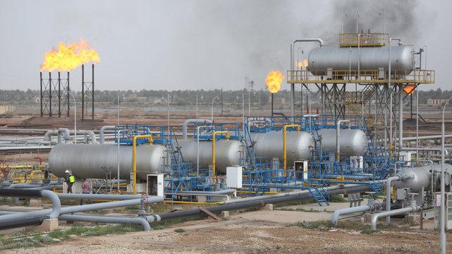 General view of Nahr Bin Umar oil field, as workers spray disinfectant as a preventive measure against coronavirus, north of Basra