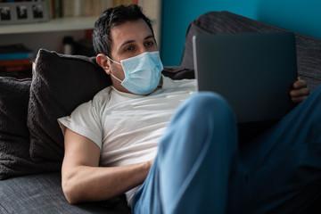 A white man is working from home during Coronavirus or Covid-19 quarantine, coronavirus covid 19 infected patient in coronavirus covid 19 quarantine room using computer