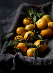 Fresh Tangerines with Leaves Ion grey linen napkin