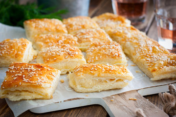 Puff pastry pie with cheese, sprinkled with sesame seeds, selective focus Fototapete