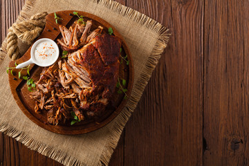 Pulled pork on a wooden board. Top view. Wall mural