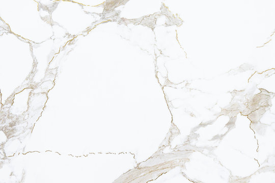 White marble stone texture with golden cracks pattern, close up background.