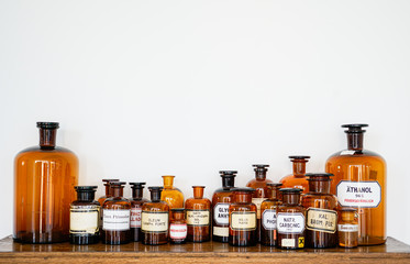 Photo sur Toile Pharmacie pharmacy bottles on wood board for interior decoration