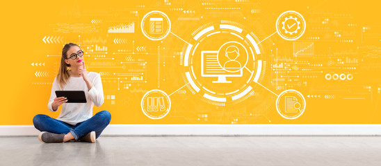 Document management system concept with young woman holding a tablet computer Wall mural