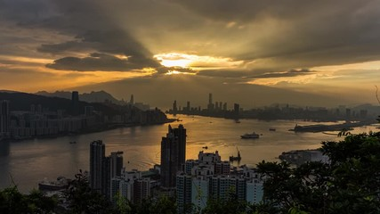 Fotomurales - Aerial view sunset at Victoria Harbor of Hong Kong from Devil's peak