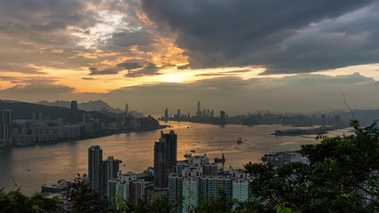 Fotomurales - Aerial view sunset at Victoria Harbor of Hong Kong from Devil's peak