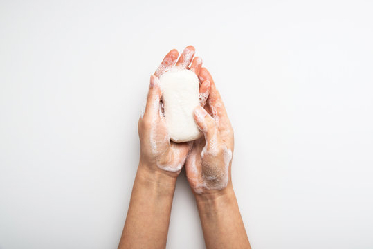 Health care hygiene protection against virus, bacteria, flu and coronavirus by washing hands with soap. White background