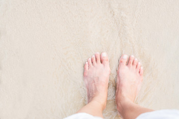 Top view of woman feet at the beach, copy space Wall mural