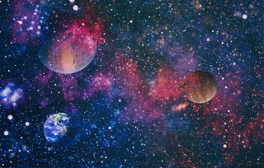 Night sky with stars and nebula. Elements of this image furnished by NASA